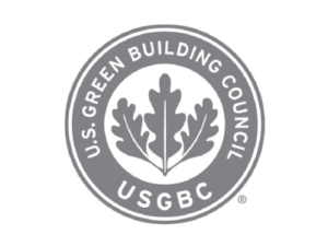 U.S. Green Building Council circular logo in grey with leaves in the middle