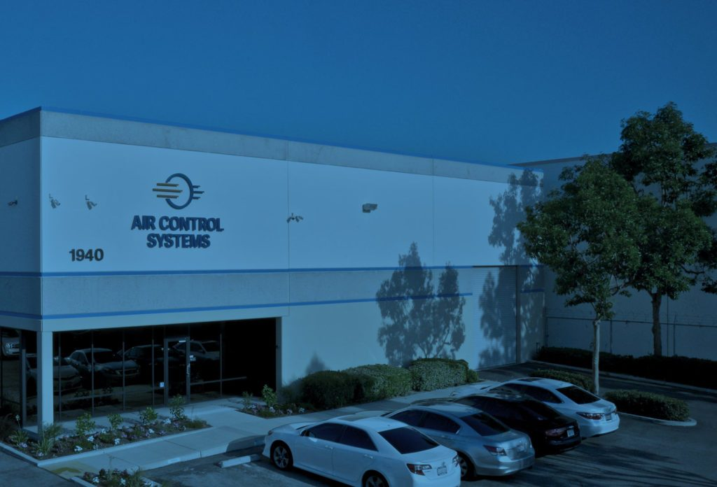 the exterior of the air control systems building from the parking lot